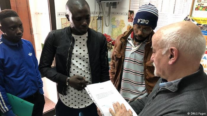 Alberto Matos and three migrants from Africa