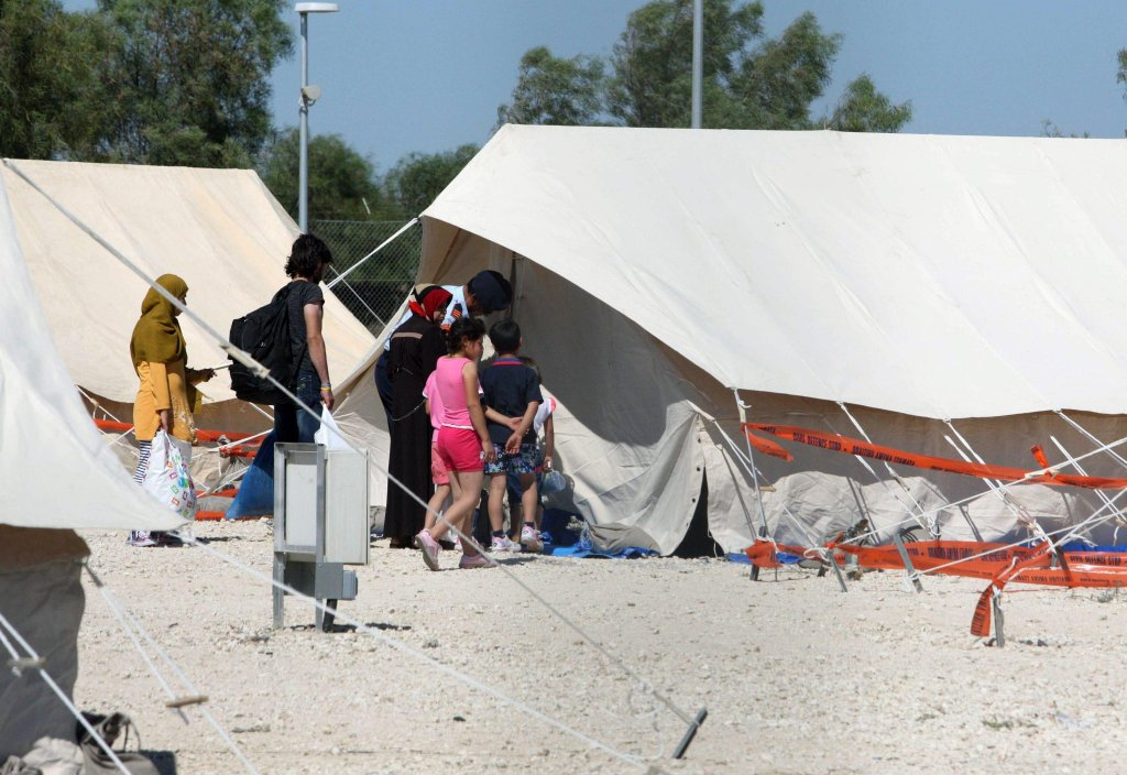 Refugees walking by tents after arriving at a designated accommodation area in the village of Kokkinotrimithia, near Nicosia, Cyprus.  Photo/Archive/EPA/KATIA CHRISTODOULOU