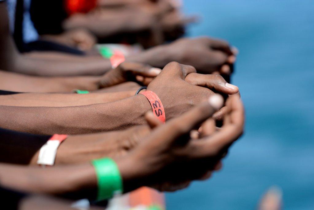 REUTERS/Guglielmo Mangiapane |Migrants à bord de l'Aquarius en mer Méditerranée, 15 août 2018.