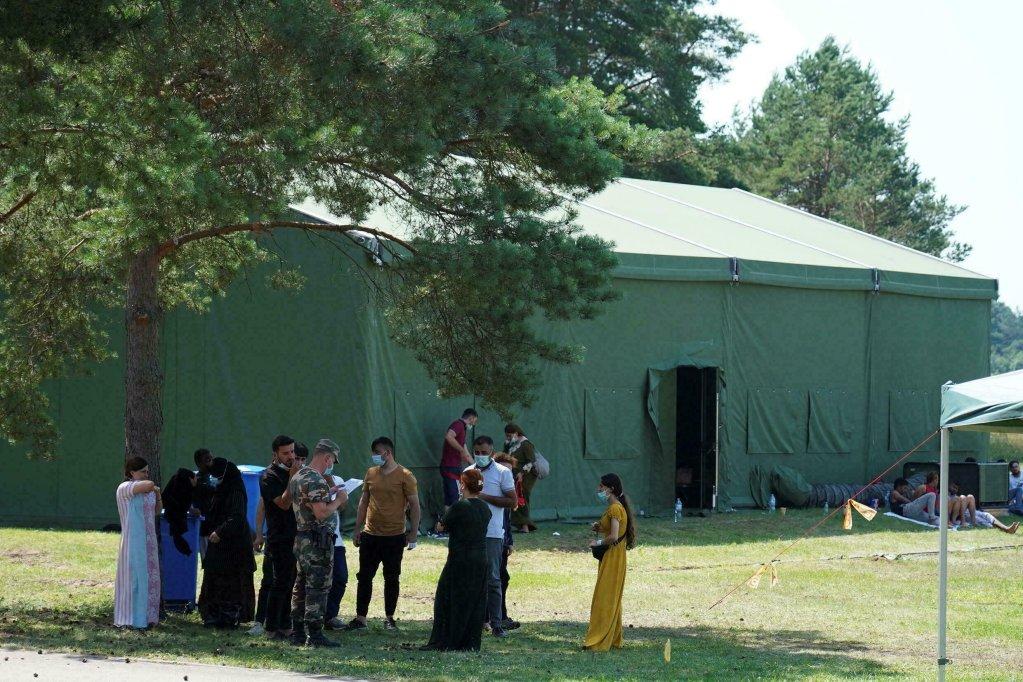 مهاجرون عند نقطة تفتيش ليتوانية ، 9 يوليو/تموز 2021 .