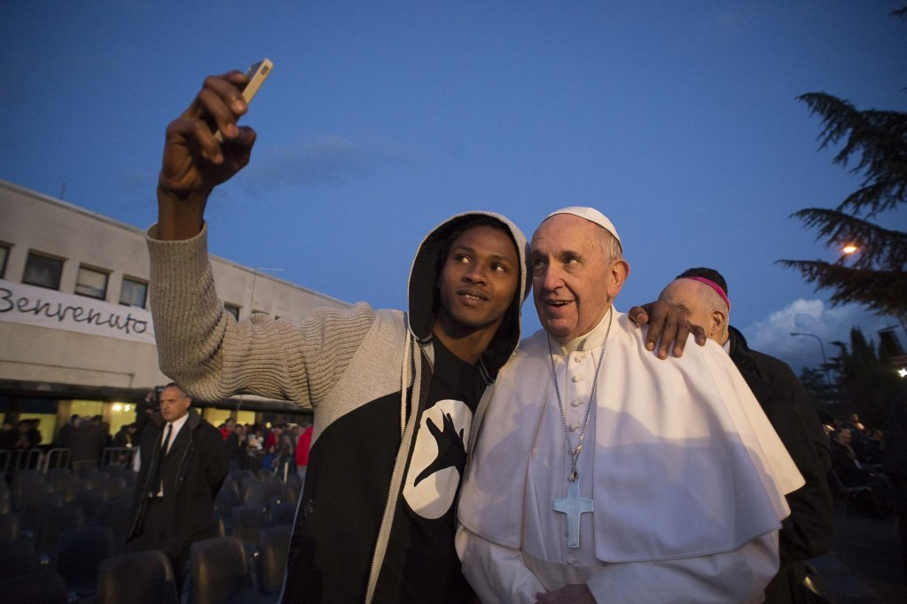 Pope Francis posing for a selfie during a visit to the Castelnuovo di Porto refugee center, Rome. Photo | EPA/OSSERVATORE ROMANO