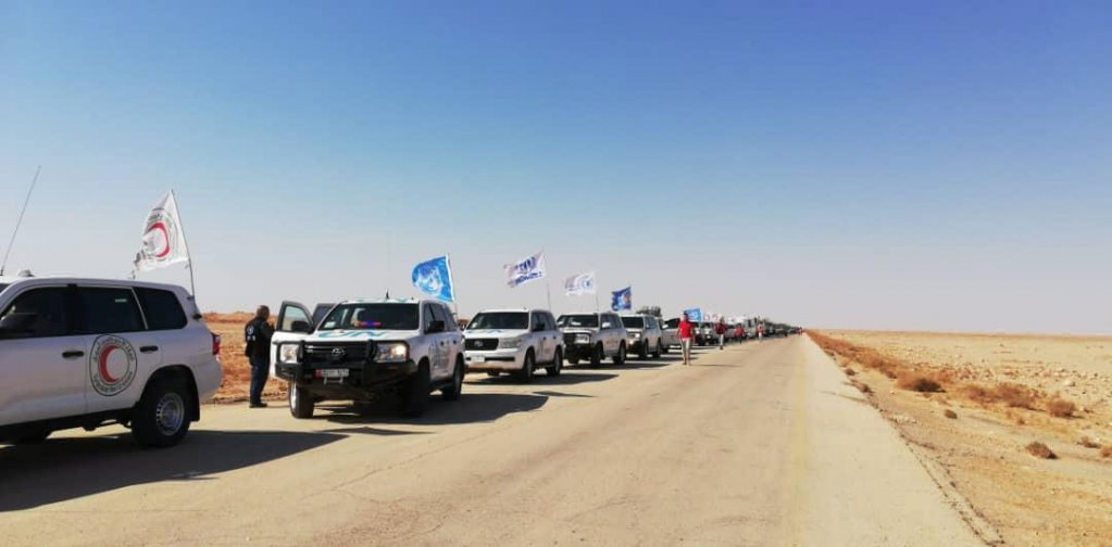 UN and SARC convoy drives to deliver humanitarian assistance to displaced Syrians at Rukban camp near the Jordanian border, southeast Syria | Photo: EPA/SARC