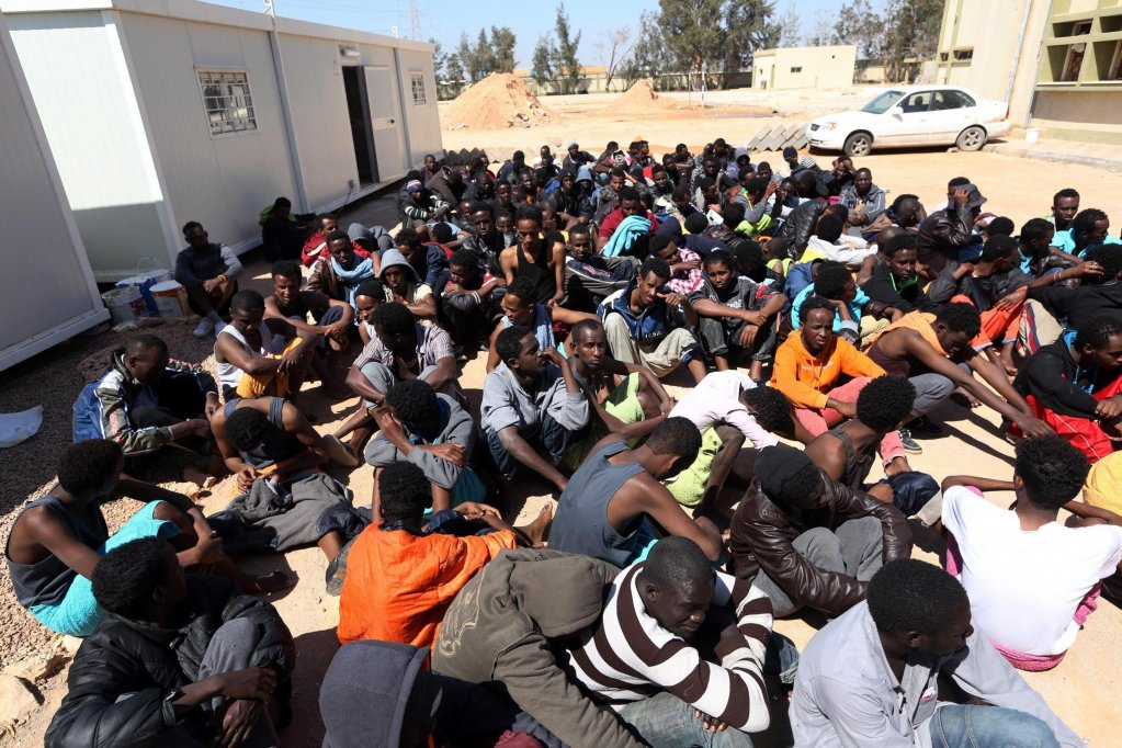Migrants in a detention center in Libya | EPA/STR