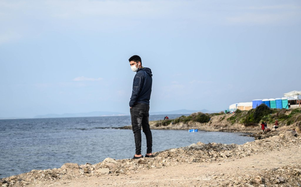 From file: A migrant stands by the sea at Karatepe refugee camp on Lesbos island, Greece   Photo: Vangelis Papantonis / Archive / EPA