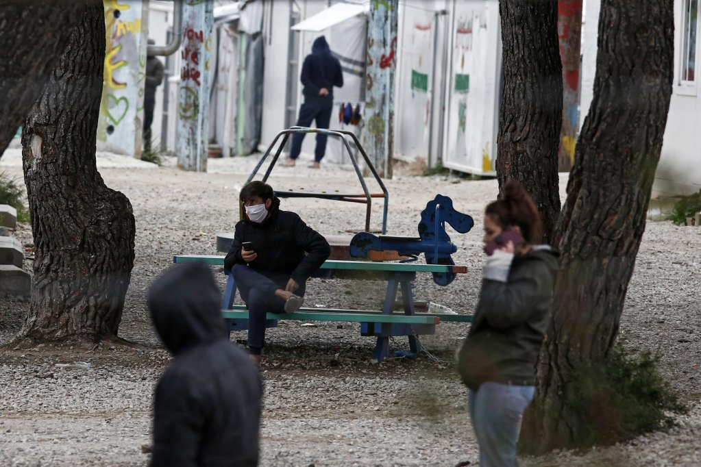 Migrants at the Ritsona refugee camp in Greece which was put on lockdown after 23 residents tested positive for COVID-19 (April 3, 2020) | Photo: EPA/YANNIS KOLESIDIS