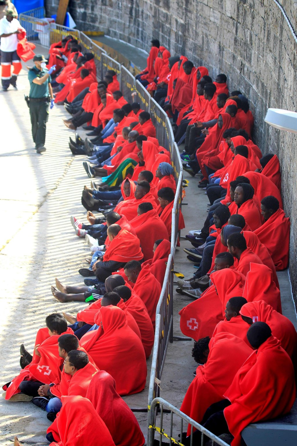 Sub-Saharan migrants resting after arriving at the port of Tarifa, Cadiz in Southern Spain at the weekend Photo: EPA/A. Carrasco Ragel