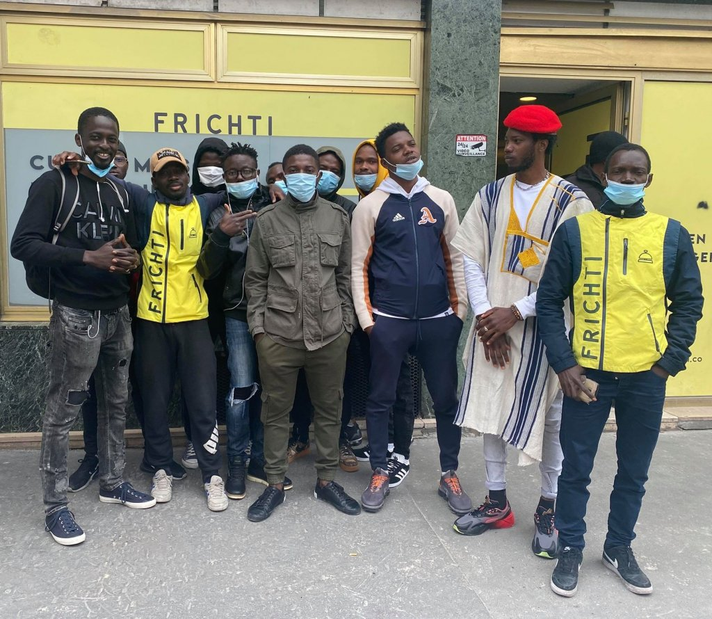 "Undocumented deliverymen in front of the Frichti ""Hub"" in the 11th arrondissement of Paris. Credit: InfoMigrants"
