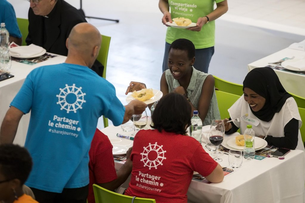 This photo shows migrants and refugees at the San Giovanni Paolo II cafeteria of Caritas Dioscesana Photo/Archive/Angelo Carconi