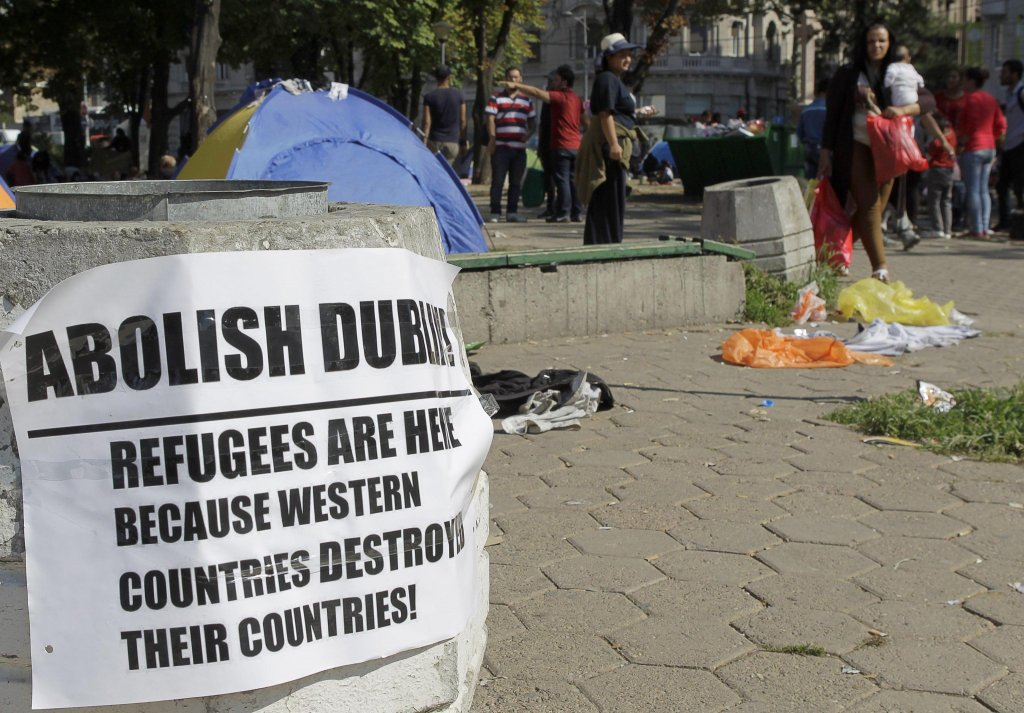 A banner in a park in downtown Belgrade, Serbia against the Dublin regulation which reads: 'Abolish Dublin, refugees are here because Western countries destroyed their countries' | Photo: ARCHIVE/EPA/Andrej Cukic