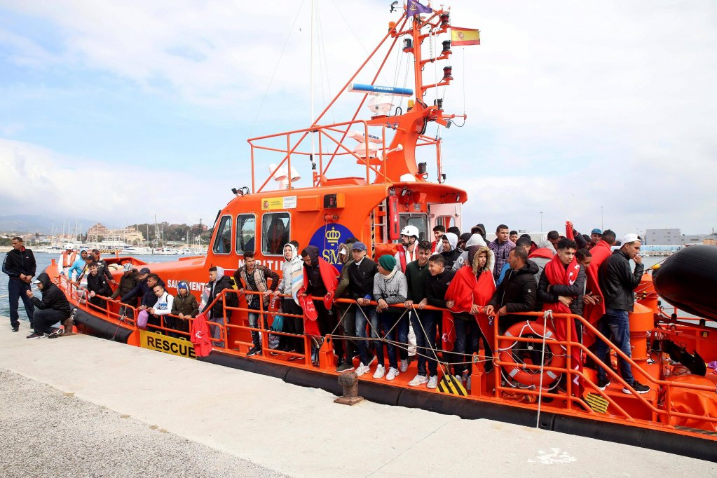 Moroccan migrants arrive in the port after they were rescued by Spanish authorities in the town of Algeciras, Cadiz, southern Spain, 12 May 2018. Spanish Sea Rescue Unit rescued a total of 95 Moroccan migrants in the waters off the Strait of Gibraltar. EPA/A.Carrasco Ragel