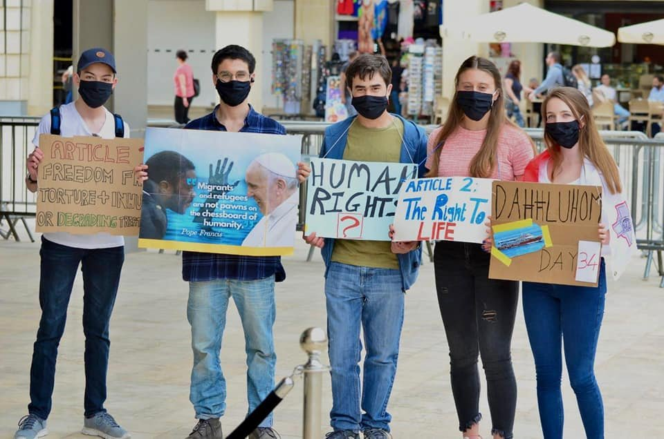 Students protesting outside the Maltese parliament at the treatment of migrants being held offshore | Source: Facebook site of Xandru Cassar (student protestor- pictured second from left)