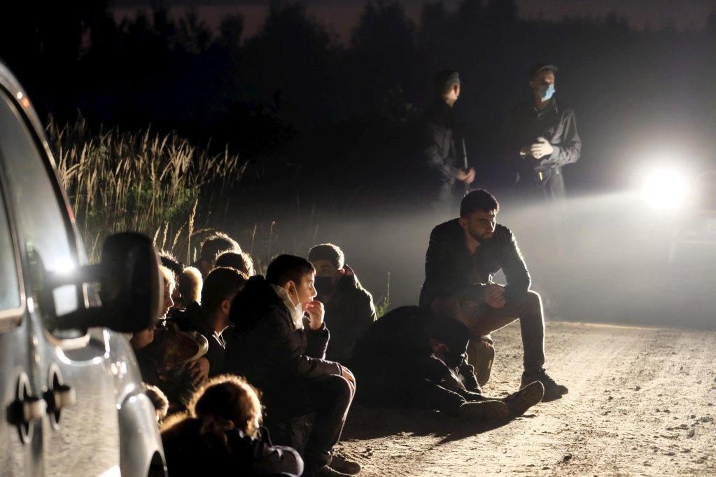 A group of migrants detained near the Belarus-Latvia border on August 11, 2021 | Photo: EPA/Valda Kalnina