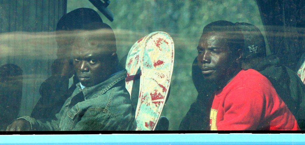 Archive: African farmhands on a bus in Rosarno, Calabria | Photo: TONY VECE/ANSA