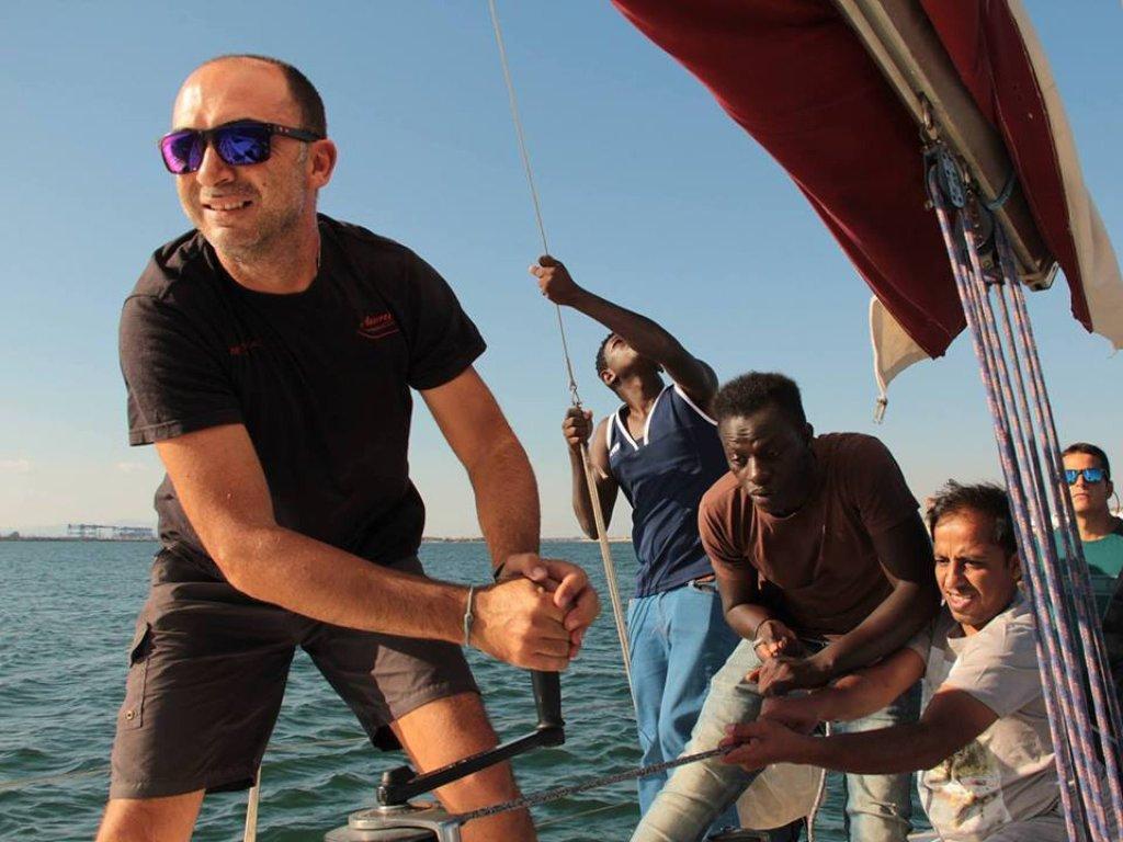 Simone Camba with the young men he helps through his association Sardiniasail | Credit: ANSA