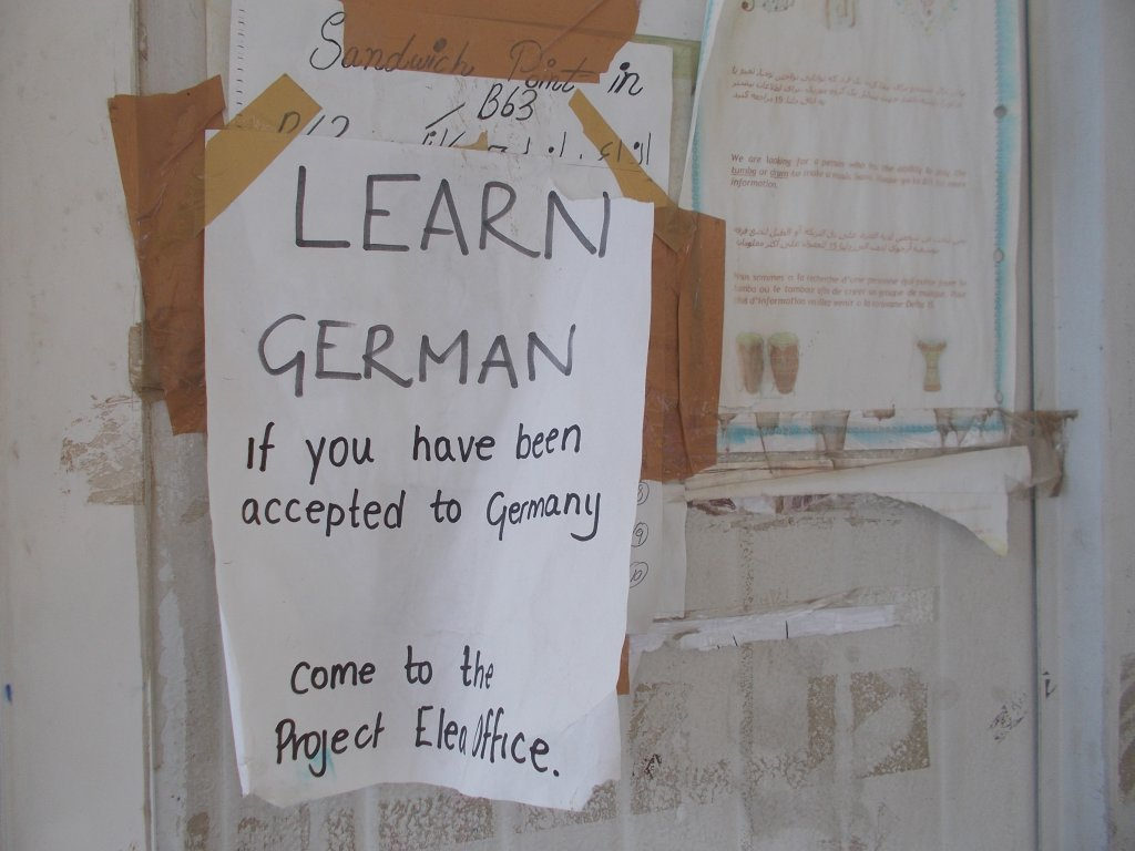 A sign posted at a reception center | Credit: Jannie Pappadimitriou