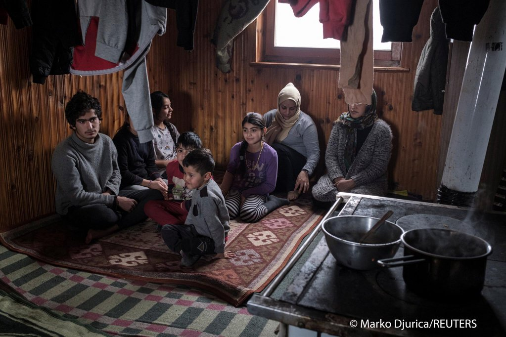 From file: Two migrant families from Iraq and Afghanistan share this small abandoned house near Velika Kladusa in Bosnia | Photo: REUTERS/Marko Djurica