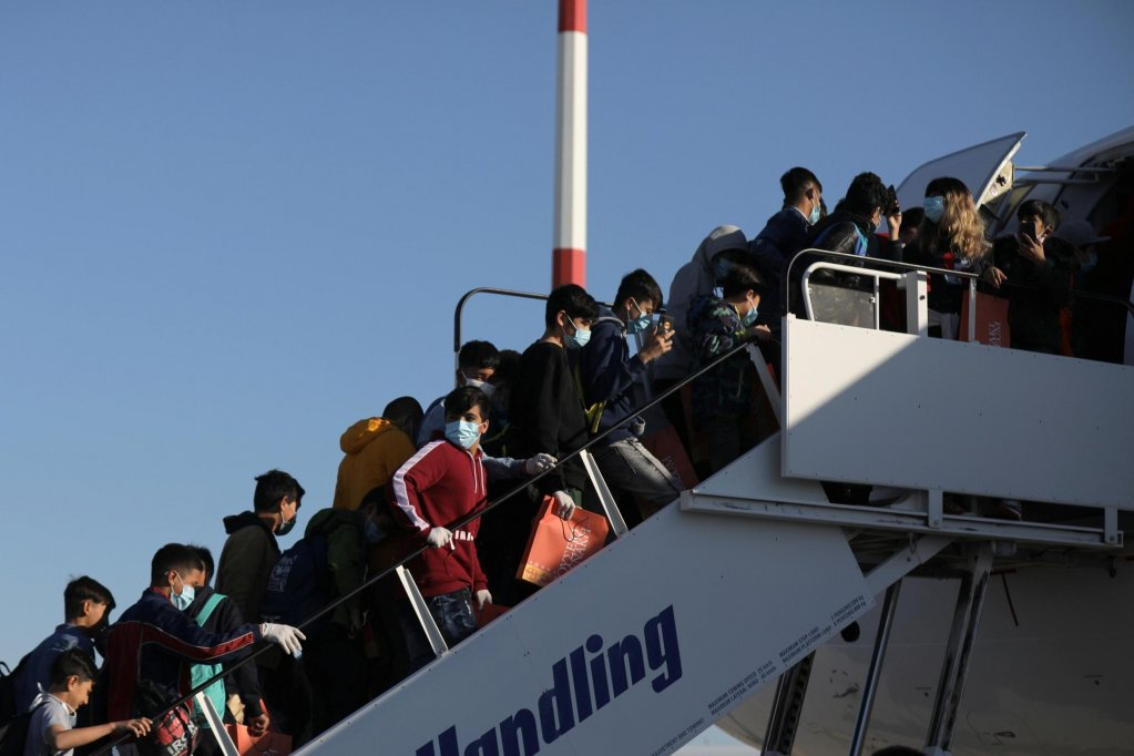 From file:  Unaccompanied minors board a plane to travel from Athens to Germany, April 18, 2020 | Photo: REUTERS/Costas Baltas