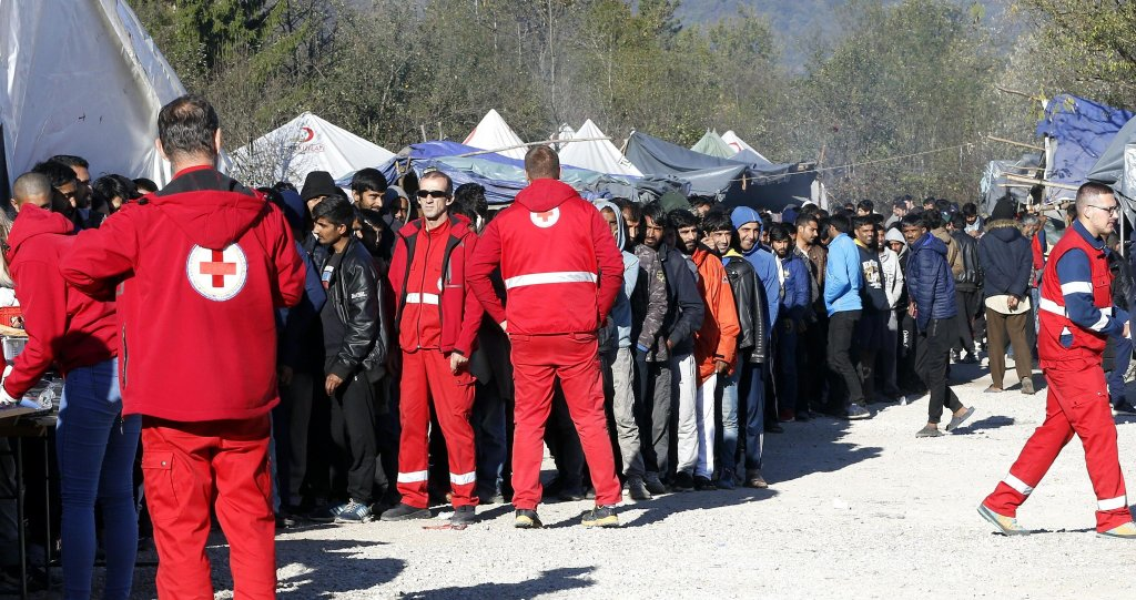 Migrants waiting in line for food at camp 'Vucjak' in Bihac, Bosnia | PHOTO: ARCHIVE/EPA/Fehim Demir