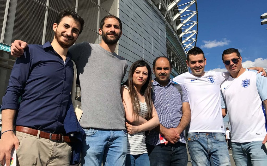 Ahmad Al Rashid, second to right, came to UK in July 2015 - he now works for the IOM in integration and resettlement programs