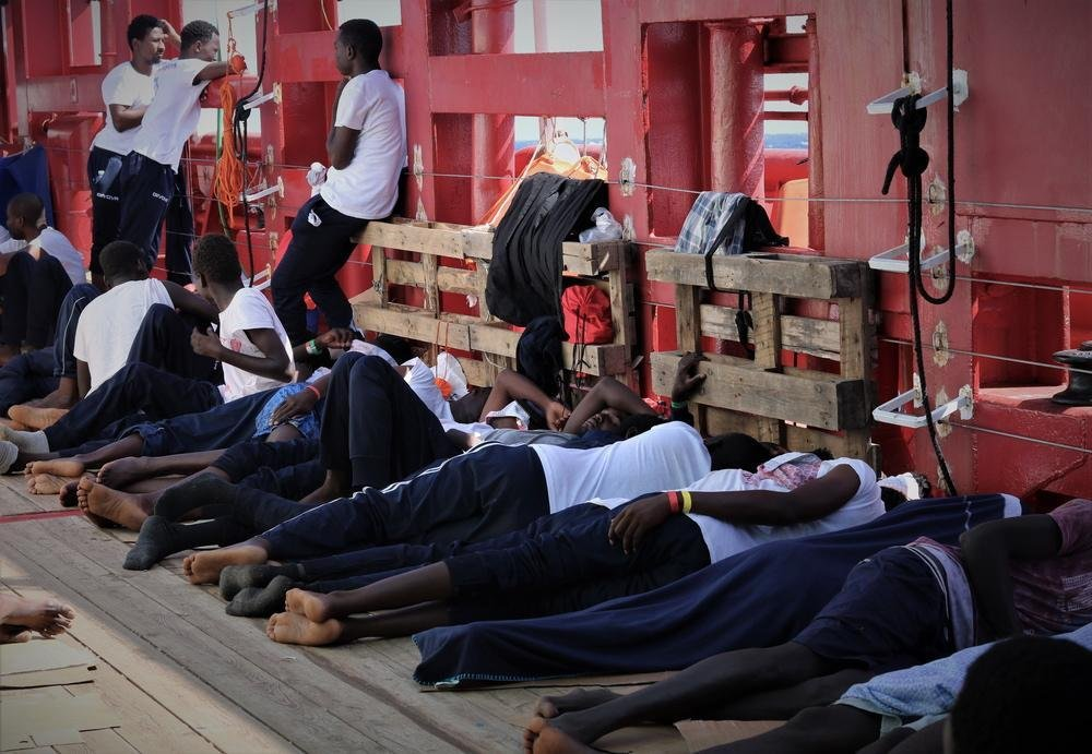 Migrants resting on the Ocean Viking following their rescue off the coast of Libya | Photo: EPA/HANNAH WALLACE BOWMAN