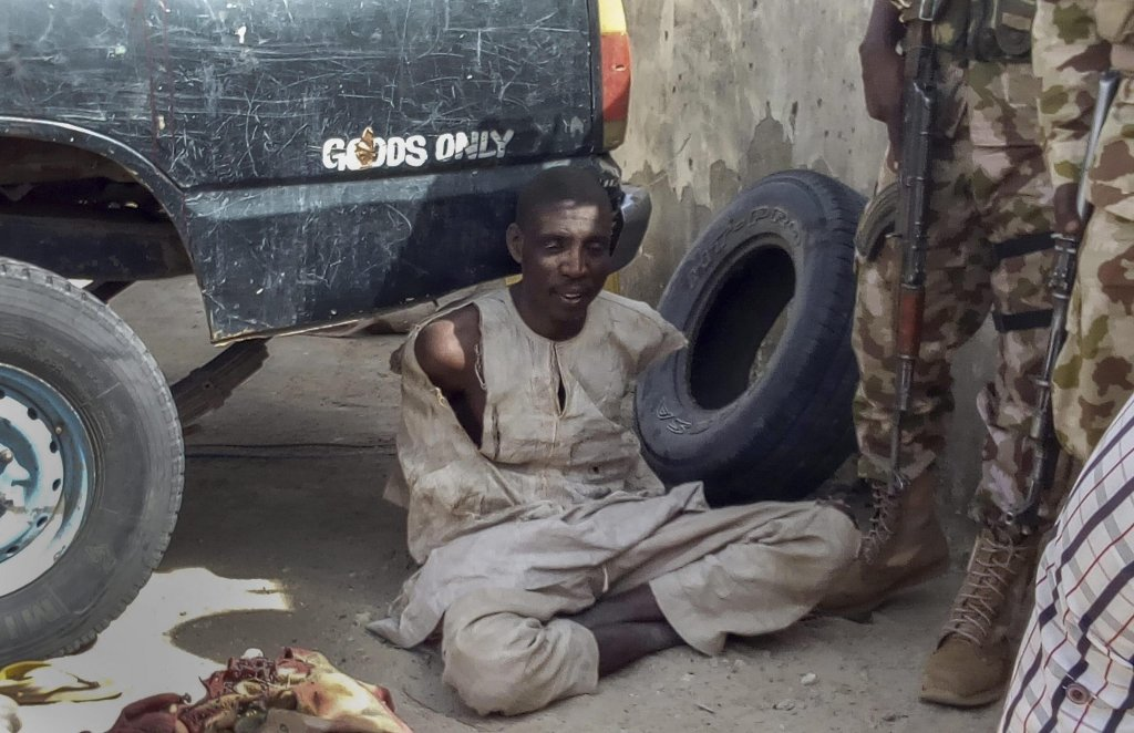 Nigerian troops detain a suspected Boko Haram militant in Rann, Nigeria | Photo: EPA/STR