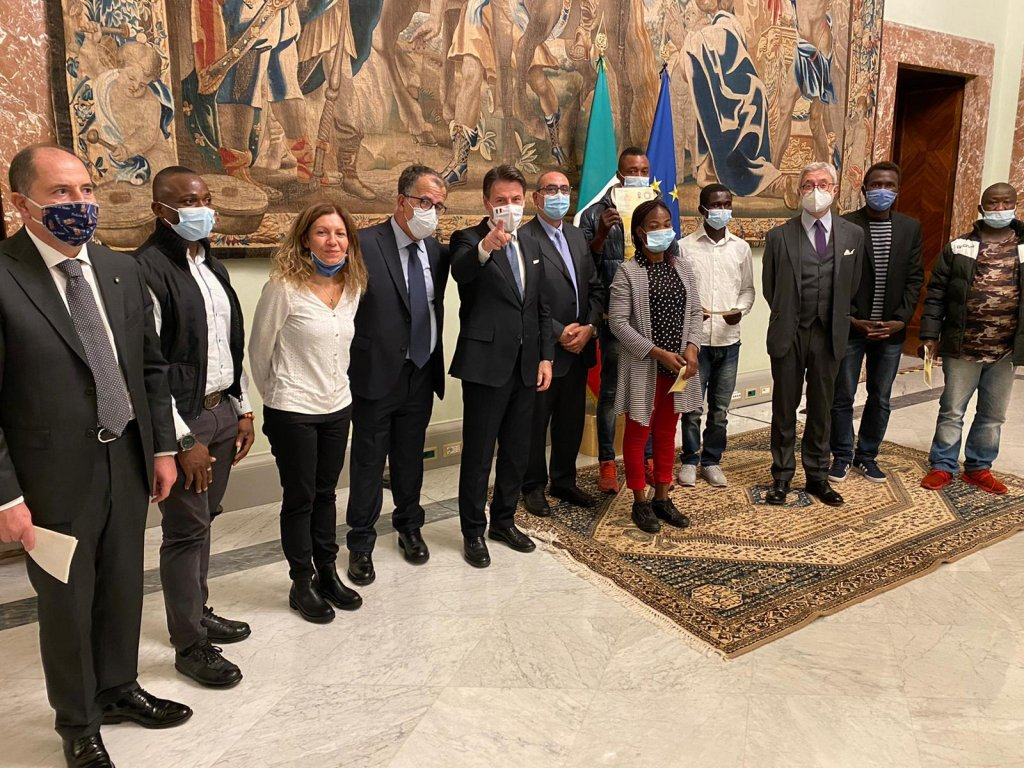 A scene from the ceremony at Palazzo Chigi in which Italian Premier Giuseppe Conte presented stay permits to four foreign citizens who were involved in a terrible episode of labour exploitation in Naples last June | Photo: FROM FACEBOOK PROFILE OF EX-CANAPIFICIO SOCIAL CENTRE CASERTA