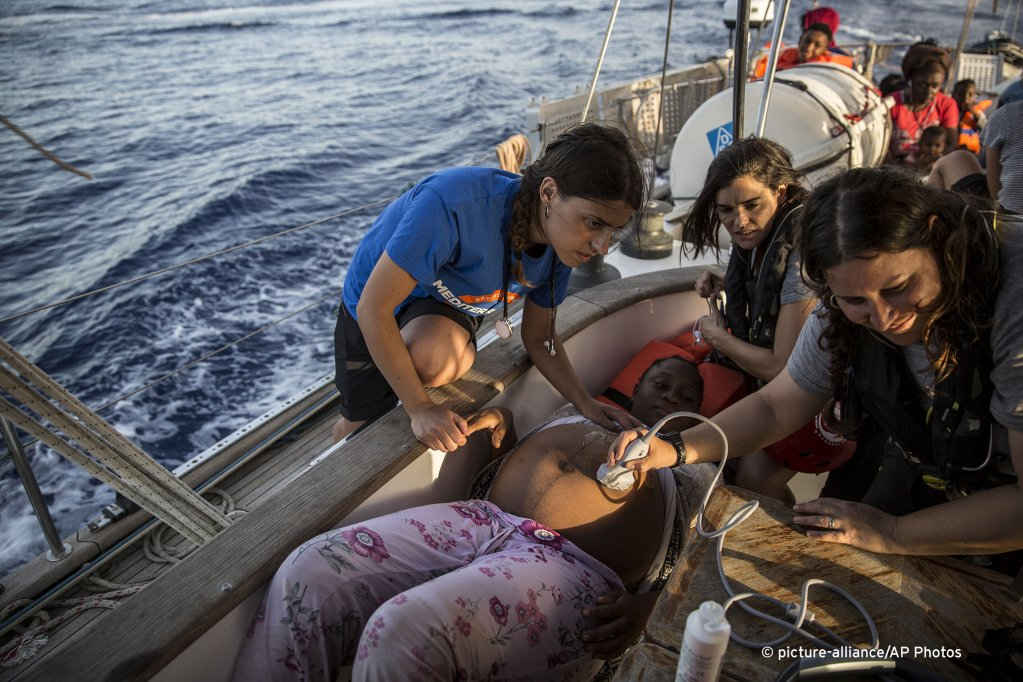 A pregnant woman being examined after rescue by Italian NGO Mediterranea Saving Humans | Photo: Picture-alliance/AP Photos