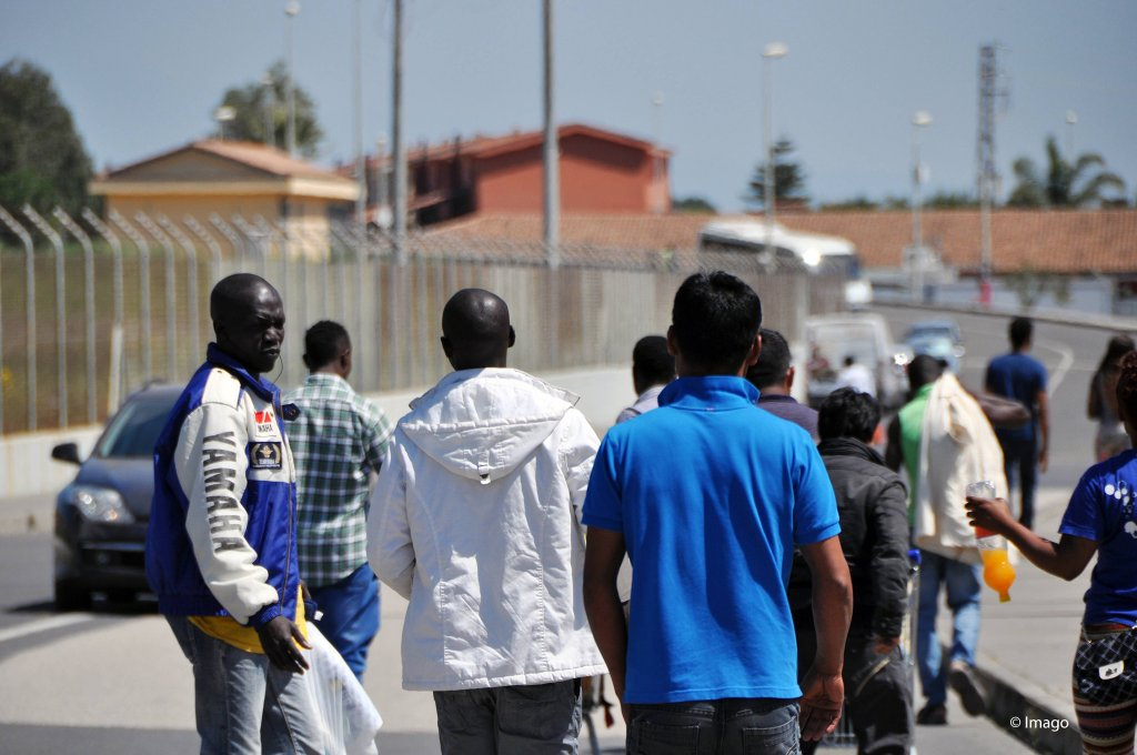 From file: Asylum seekers walk in Cara di Mineo, Europe's largest reception center for asylum seekers, around 70 sm west from the port city of Catania in Sicily, Italy Nov 4 2015 | Photo: Imago/xinhua