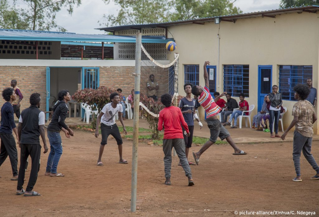 Refugees evacuated from Libya play volleyball at the Gashora transit center, eastern Rwanda on October 23, 2019 | Photo: Cyril Ndegeya/Xinhua