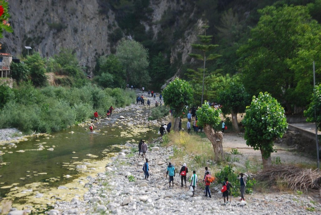 From file: A picture of migrants walking along the Roja river, near Ventimiglia, Italy northwest, towards the French border, June 26 2017 | Photo: Chiara Carenini /ANSA