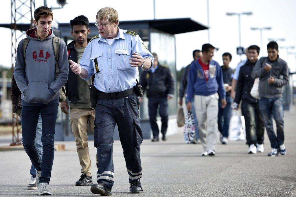 From file: Migrants after arriving in Denmark from Germany in September 2015 | Photo: EPA/Jens Noergaard Larsen