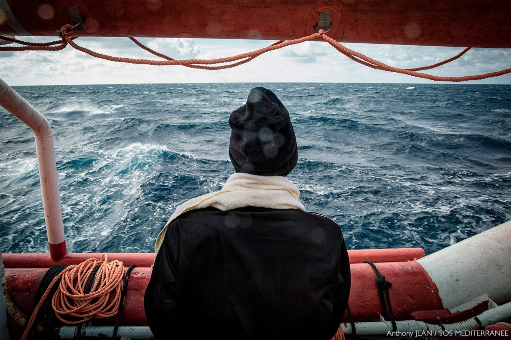 A migrant on board the Ocean Viking looks out at the Mediterranean while waiting for a place of safety in which to disembark | Photo: Anthony Jean / SOS Mediterranee @SOSMedIntl