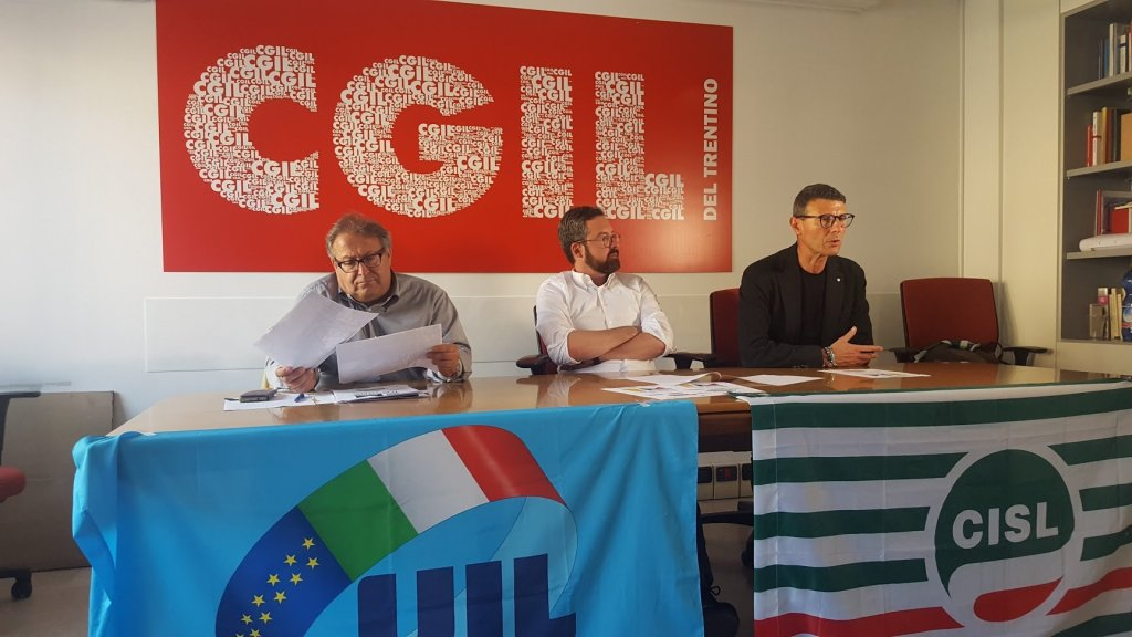The heads of the CGIL, CISL, and UIL unions have presented a new five-language handbook to explain the world of work to those with limited Italian skills in the CISL offices in Trento | Photo: ANSA