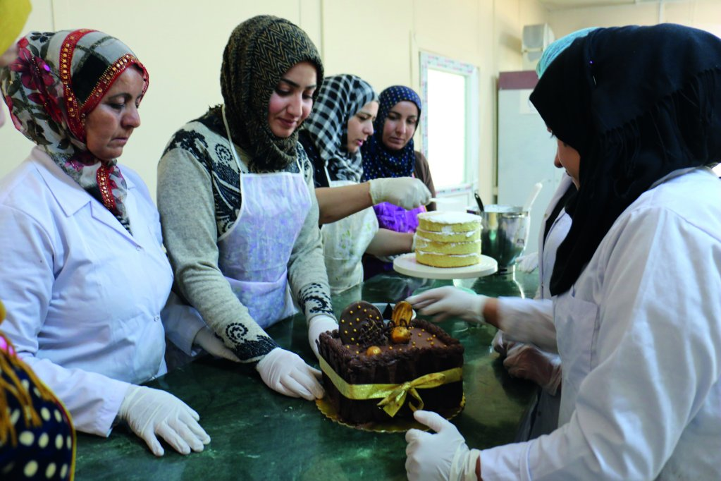 Syrian refugees set up the Jeenda Sweet Factory in Domiz Camp, northern Iraq | Photo: IOM, 2017