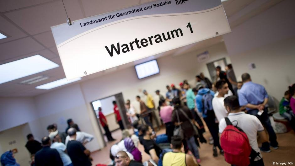 Asylum seekers waiting at a reception center in Berlin. BAMF received 190,000 asylum applications in the first eight months of 2015