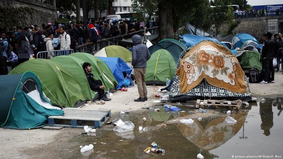 Migrants are cleared out of a makeshift camp in Paris, France earlier this month.