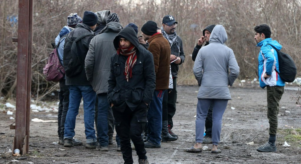 Migrants gathering in an abandoned warehouse near the border with Croatia in Adasevac, Serbia Photo: EPA/Koca Sulejmanovic