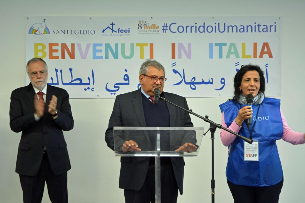In the photo, Andrea Riccardi, founder of the Community of Sant'Egidio, welcomes a group of 83 Syrian refugees who arrived in Rome thanks to humanitarian corridors. PHOTO/ARCHIVE/ANSA