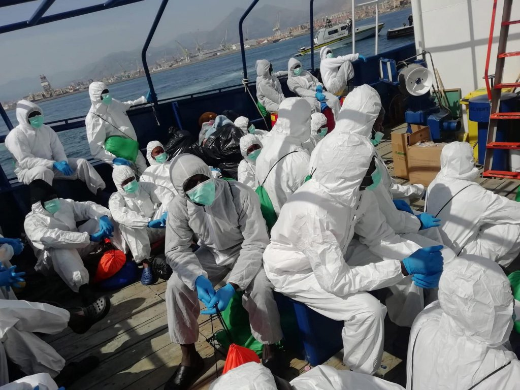 Some of the 34 migrants rescued at sea prior to their transfer from the Spanish ship 'Aita Mari' to the Italian Tirrenia ferry 'Raffaele Rubattino', off Sicily, 19 April 2020 | Photo: EPA/SALVAMENTO MARITIMO HUMANITARIO HANDOUT