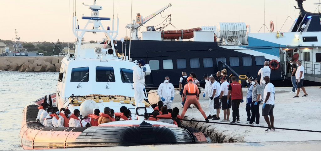 Migrants disembark from the Italian Coast Guard class 300 patrol boat that, in waters of the Maltese search-and-rescue area, transported 49 migrants from a larger group of 130 who were rescued by the ship Louise Michel, Lampedusa, Italy, 29 August 2020 | PHOTO ANSA/ELIO DESIDERIO
