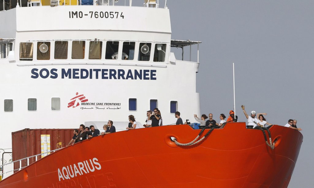 Crew members wave from the bow of the search and rescue vessel Aquarius, of the NGO SOS Méditerranée, as the ship arrives in the port of Marseille, France, 29 June 2018 | Photo: EPA/Guillaume Horcajuelo