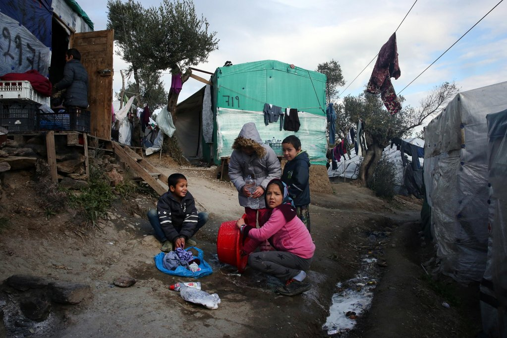 Children help with the laundry in the refugee camp of Moria, on Lesbos island, Greece | Photo: EPA/Orestis Panagiotou