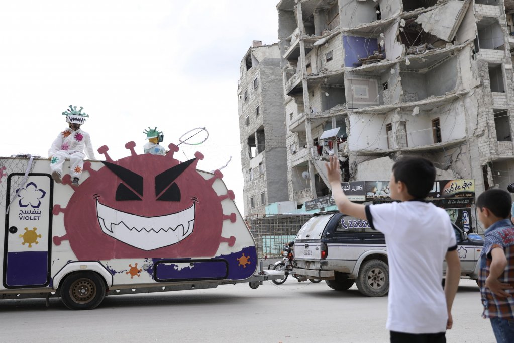 A truck propagating the prevention of COVID-19 is seen here driving  through the streets of Idlib, Syria, on April 29, 2020 | Photo: EPA/YAHYA NEMAH