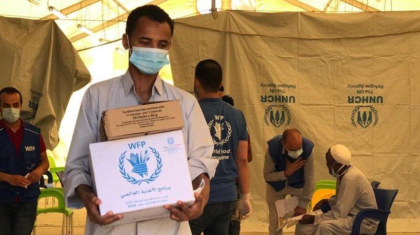 Le PAM et le HCR ont mis en place un programme d'aide alimentaire pour les migrants en Libye. Crédit : HCR