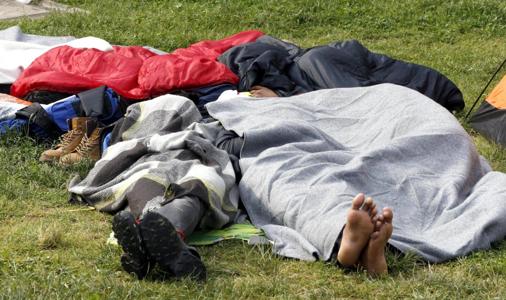 People from Afghanistan, Pakistan and Syria rest in a park in Sarajevo, Bosnia. Credit: EPA/FEHIM DEMIR