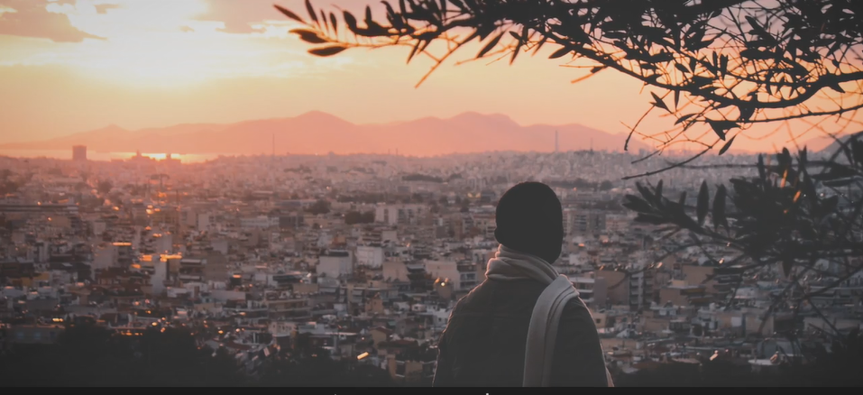 Joseph Baruku looks out over Athens at night. LGBT refugees and asylum-seekers can face even more discrimination and difficulty finding a place to live | Source: Screenshot from Safe Place International