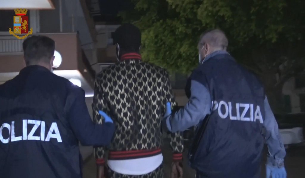 Italian police arresting a man in connection with an investigation into human trafficking in Catania, Sicily. The criminal organization was exploiting young Nigerian women forced into prostitution |Photo: ANSA/Polizia di Stato