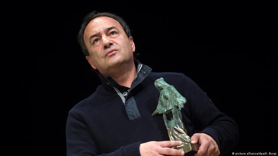 Lucano was hailed as a visionary for using integration as a motor for revitalizing his dying Italian village   Photo: picture alliance/dpa/A. Burgi