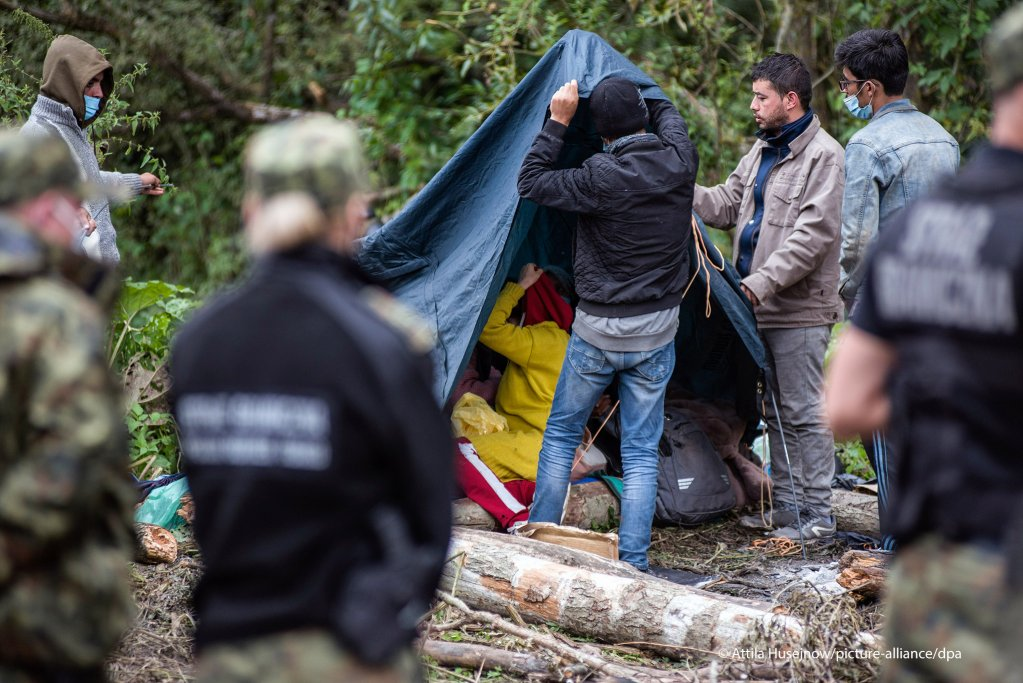 Afghan refugees seen putting up a tent on the Polish-Belarusian border   Photo: Attila Husejnow/SOPA Images/ZumaPress