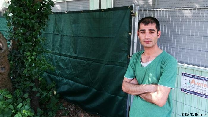 Refugee Reber Marif in front of his asylum home in Cologne